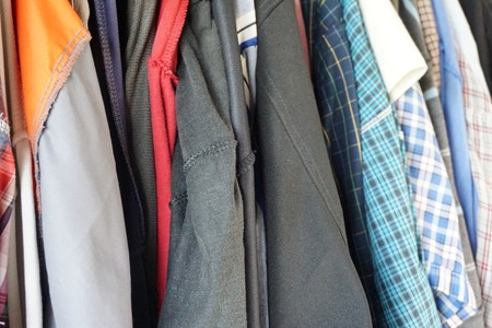close up Different clothes on hangers Stock Photo