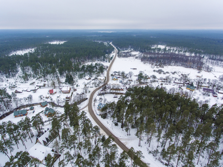 Aerial view over Latazeris village covered in snow. Winter season in Lithuania. Stock Photo