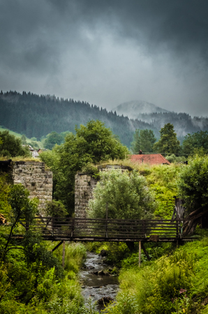 Beautiful Vorokhta place in Ukraine. Stone wall and old bridge. Ukraine