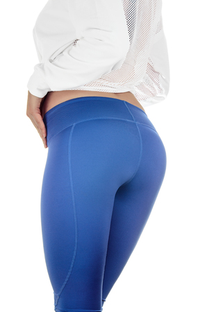 Closeup of fitness woman with fit cheeks, tight hips and firm buttocks in workout leggins. Perfect female ass in shape of sexy bottom and big butt. Slim girl body isolated on white background. Stok Fotoğraf