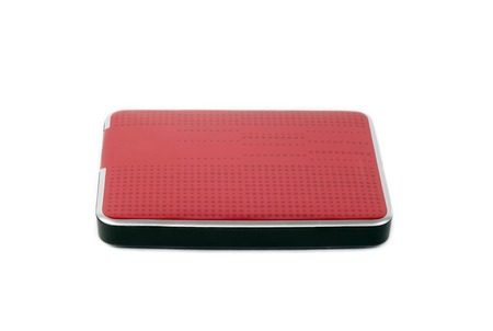 Red external hard drive for data storage and security. Portable disk hdd isolated on white background.