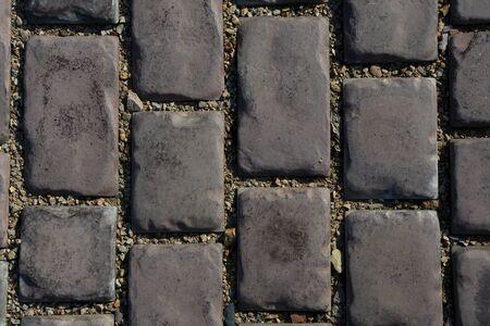 Stone background - gray paving stones, close up