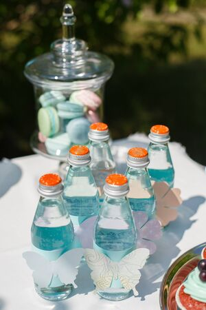 sparkling water in the same bottles for guests at the holiday