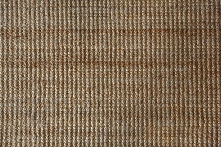 Background and texture of a yellow sisal or jute mat, wool