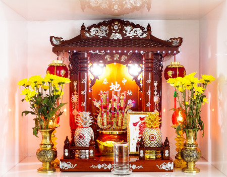 Chinese household shrine in a floor dashboard Stock Photo