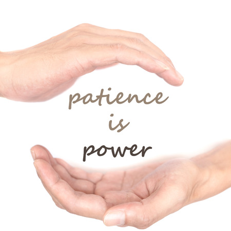 patience: Hands concept for patience is power. Quote is between right and left hand Stock Photo