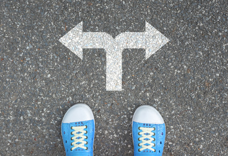 One standing at the crossroad choosing what to do next Standard-Bild