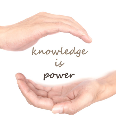 supernatural power: Hands concept for knowledge is power. Quote is between right and left hand Stock Photo