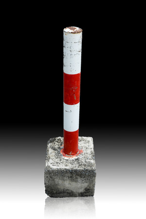 blockage: parking blockage device made by steel and concrete in red and white