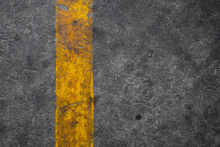 yellow line: concrete floor with yellow line Stock Photo