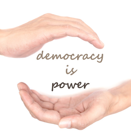 democracy: Hands concept for democracy is power. Quote is between right and left hand Stock Photo