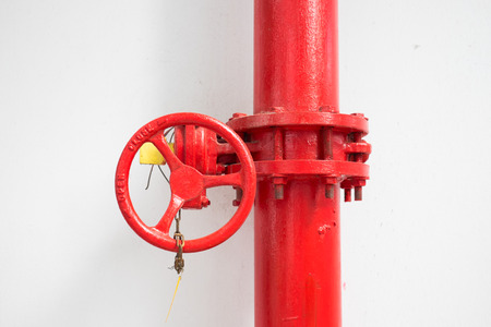 firefighter: red firefighter water pipe with manual valve