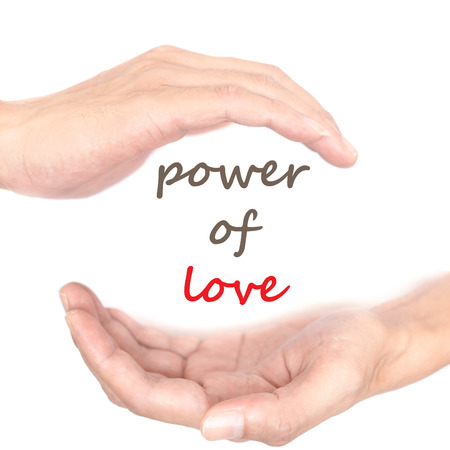 supernatural power: Hands concept for power of love. Quote is between right and left hand