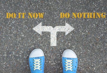 nothing: Blue shoes has decision to make at the cross road - do it now or do nothing Stock Photo