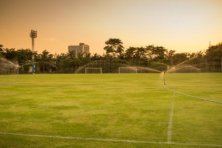 sprinkling: water sprinkling in soccer field