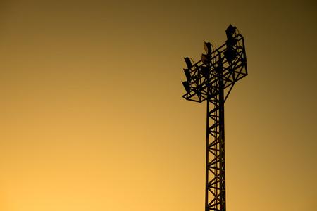 halogen lighting: Stadium spotlight in orange evening sky