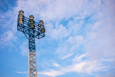 halogen lighting: Stadium spotlight in cloudy blue sky