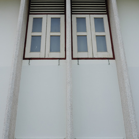 second floor: Old style windows in old house on second floor Stock Photo