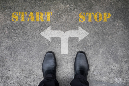 start to cross: Black shoes has decision to make at the cross road - start or stop Stock Photo