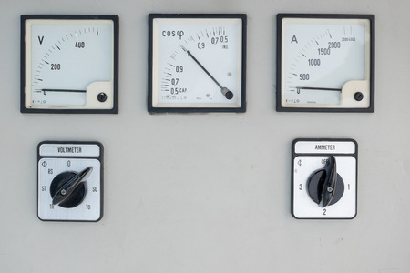 amp: Old analog electric volt and amp meter