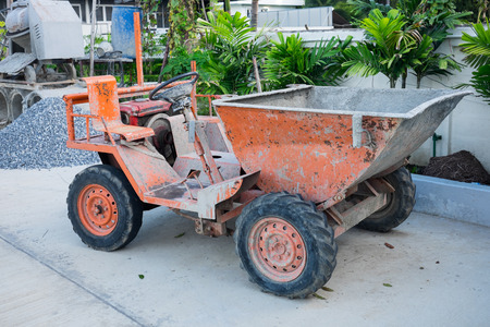 dumper: Old small dirty dumper truck at construction site Stock Photo