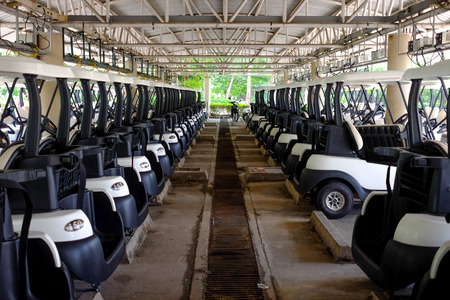 Lot of golf carts parking in the parking area no recognized trademark in this picture Stock Photo