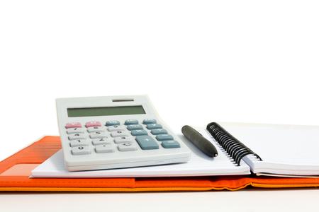 孤立した電卓、ノートと白い背景のペン 写真素材