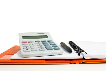 Isolated calculator, notebook and pen on white background