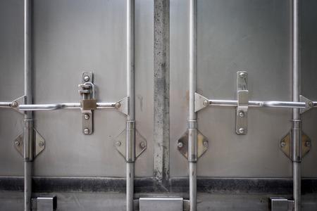 Truck's back door locked with a key Imagens