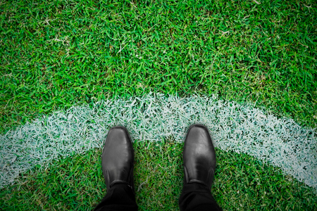 black shoes standing on the football field Stock Photo