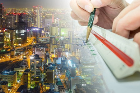 surveyors: engineer are measuring distance in drawing using pencil and ruler building whole world. Stock Photo