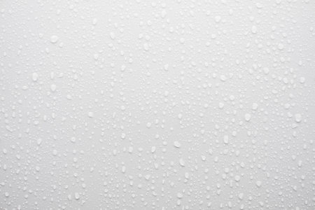 water drop on white surface as background Stock Photo