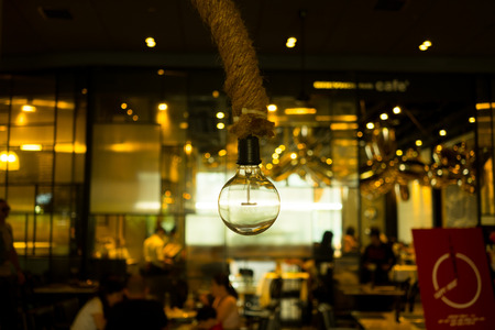 hanging lamp: Hanging lamp and abstract blur restaurant in the background Stock Photo