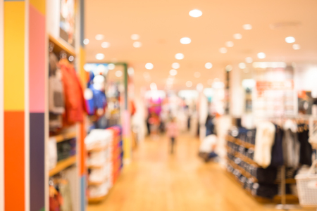 clothing stores: Abstract blur fashion mall interior as background