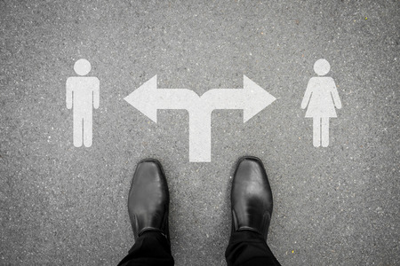Black shoes standing at the crossroad - male or female