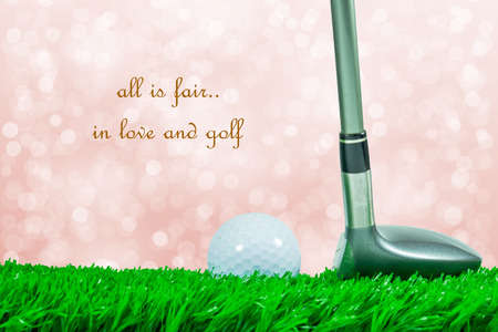 pelota de golf: White golf ball and fairway wood on green artificial grass and off focus background and quote  all is fair in love and golf  Foto de archivo