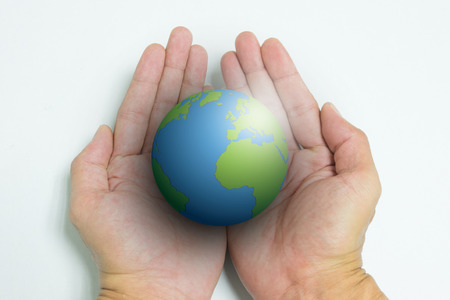 earth handful: Isolated opened hands and the earth on white background Stock Photo