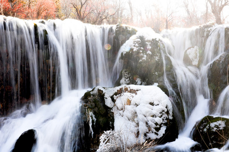 Frozen water fall in spring season - Jiuzhaigou, China Imagens - 50549267