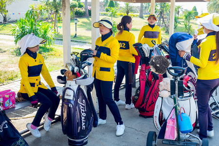 tee off: Ayuthaya, Thailand - December 27, 2015 : Caddie girls waiting for tee off time Editorial
