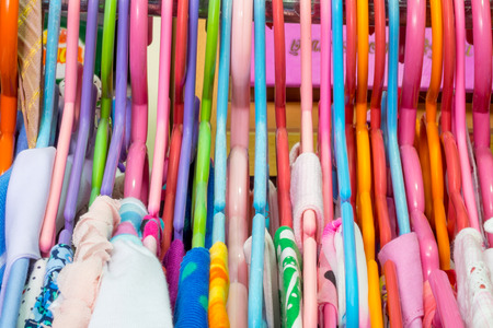 clothes rack: Lot of colorful clothes hangers hanging on the rack