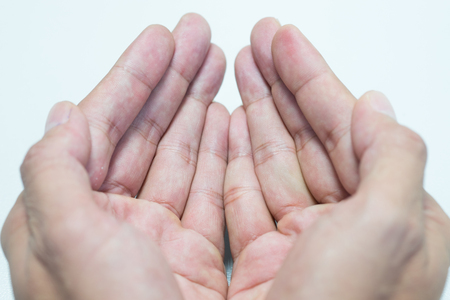begging: Isolated opened hands giving or begging