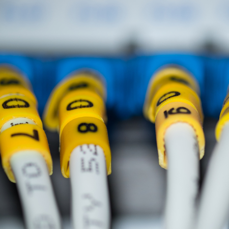 Lan cables connected to the hub with number marked on the wire
