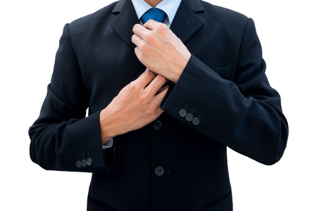 new opportunity: Businessman in dark gray suit rearrange his neck tie for new opportunity, new life, new success