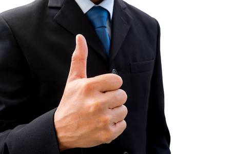great suit: Isolated businessman in dark gray suit raising his thumb up represent business success, good job, ok, great and all good things.