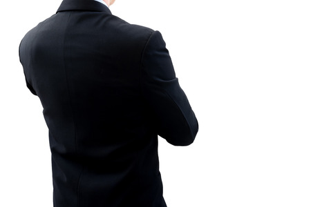 new opportunity: Isolated back side of businessman in dark gray suit standing and crossing ones arm. He is looking for new opportunity and business success