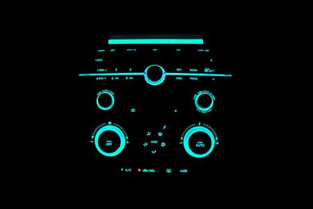 Light blue light car dashboard console in the dark