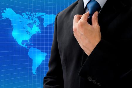 rearrange: Isolated businessman in dark gray suit rearrange his neck tie for global business Stock Photo