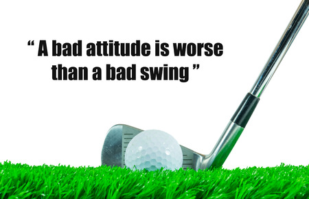 bad attitude: White golf ball and iron club on green artificial grass with white background and quote  a bad attitude is worse than a bad swing