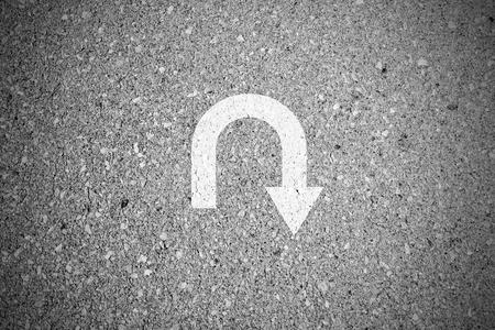 turnaround: White u turn sign on asphalt concret street as background Stock Photo