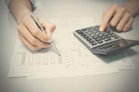 to analyze: A man analyze summary report about business